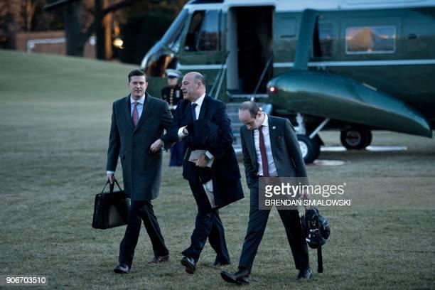 White House Staff Secretary Rob Porter National Economic Council Director Gary Cohn and advisor Stephen Miller follow US President Donald Trump as he...