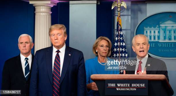 White House Trade and Manufacturing Policy adviser Peter Navarro speaks alongside US President Donald Trump Vice President Mike Pence and Education...