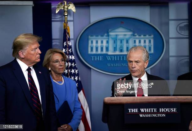 White House Trade and Manufacturing Policy Director Peter Navarro speaks as U.S. President Donald Trump and Secretary of Education Betsy DeVos during...