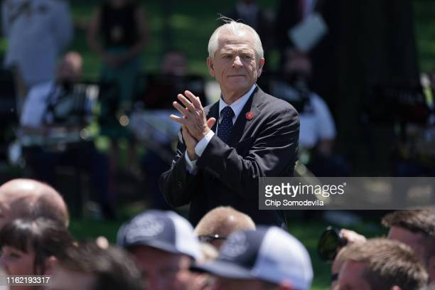 White House Trade and Manufacturing Policy Director Peter Navarro applauds for US President Donald Trump during the 'Made In America' product...