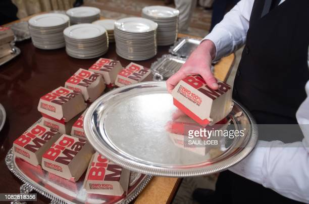 A White House usher plates Big Macs from McDonalds some of the fast food the US president purchased for a ceremony honoring the 2018 College Football...