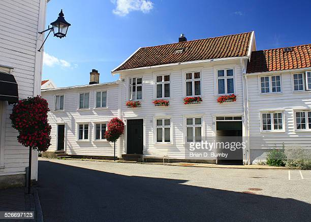 White House with flower boxes in Mandal, Norway