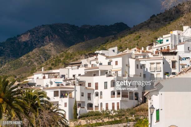 white houses at the frigiliana village on the top of the mountain - moruno fotografías e imágenes de stock