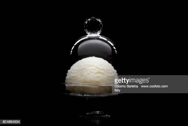 White Ice cream as a jewelry on a black background