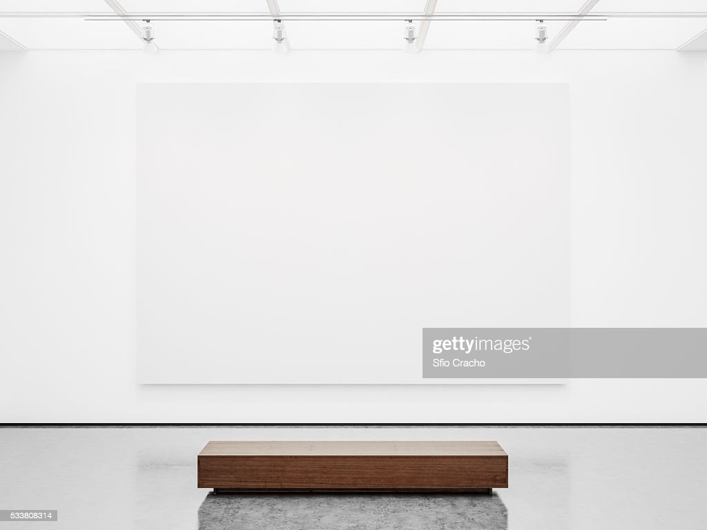 White interior of empty gallery with bench : Foto stock