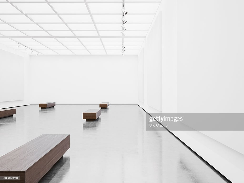 White interior of empty gallery with benches : Foto stock