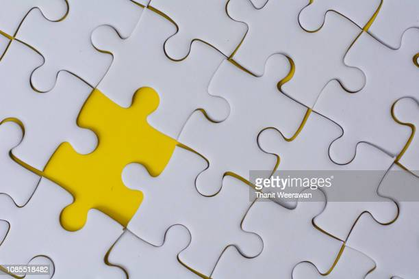 White Jigsaw puzzle on yellow color background