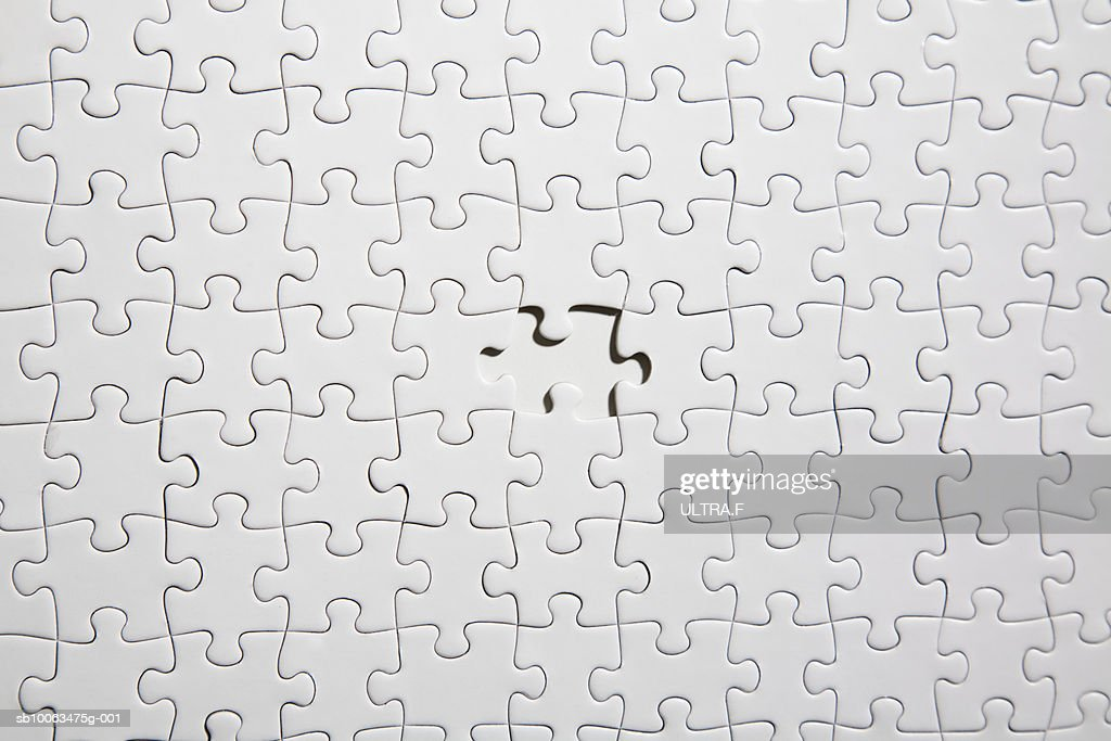 White jigsaw puzzle with one piece missing (full frame) : Stock Photo