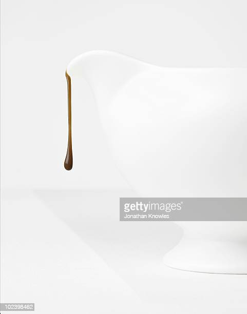 White jug with chocolate drip