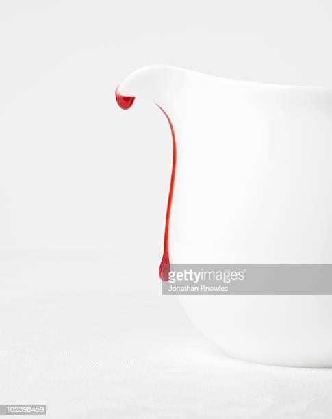 White jug with strawberry drip