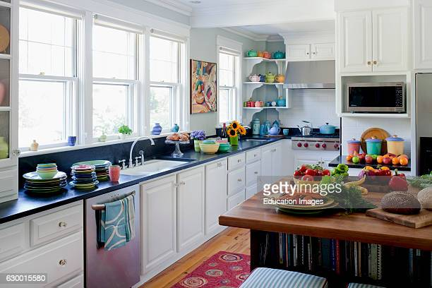White kitchen filled with colorful plates and food Cape Elizabeth ME Annie Stickney Design
