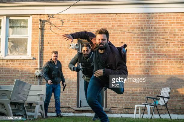 "White Knuckle"" Episode 802 -- Pictured: Patrick John Flueger as Adam Ruzek, LaRoyce Hawkins as Kevin Atwater --"