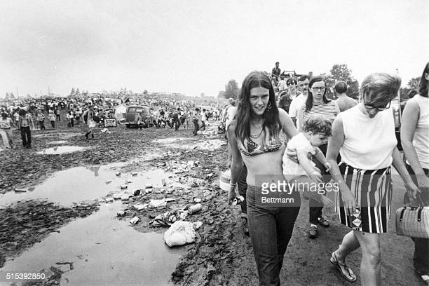 Rock music fans continue to pour into the Aquarius festival despite mud food shortages and illness among the more than 300000 spectators 8/16