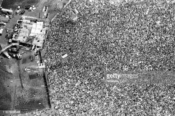 An aerial view of the crowd and stage at the Woodstock Music and Art Fair in White Lake, New York on August 17, 1969.