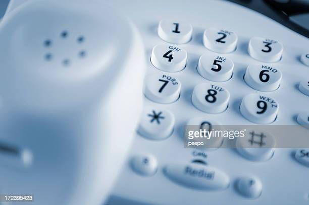 White landline telephone with keypad as focal point