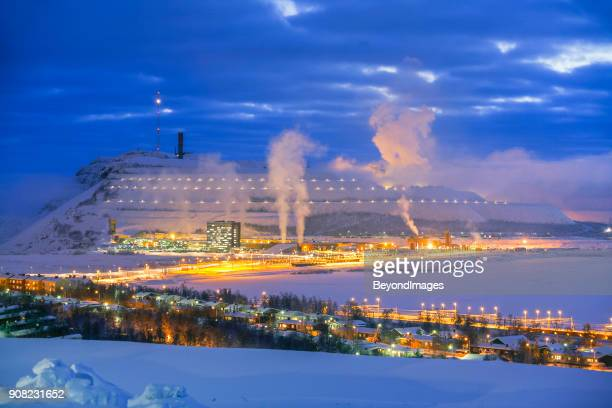 White landscape: Arctic Circle town with illuminated mountain mine on winter night