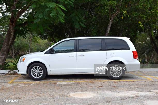 white large mpv vehicle on the street - mini van stock pictures, royalty-free photos & images