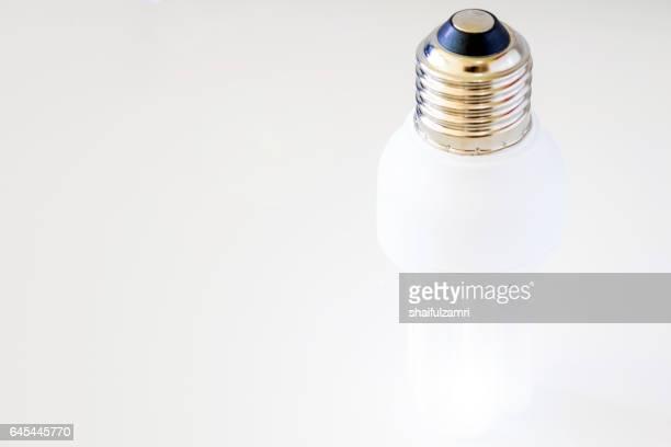 white light bulb on white background - shaifulzamri stock pictures, royalty-free photos & images