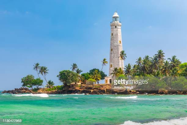 White lighthouse Dondra Head and tropical palms, Sri Lanka