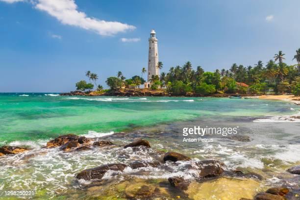 white lighthouse dondra head and tropical palms, sri lanka - sri lanka stock pictures, royalty-free photos & images