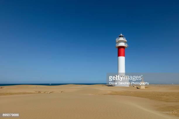 white lighthouse - delta del ebro fotografías e imágenes de stock