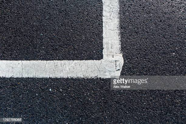 white line corner road marking on dark tarmac - pavement stock pictures, royalty-free photos & images