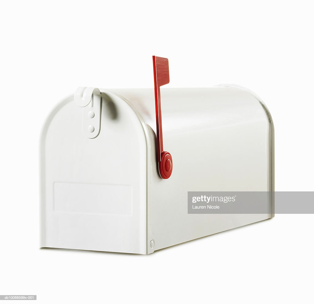 White Mailbox With Red Flag In Up Position Studio Shot Stock Photo