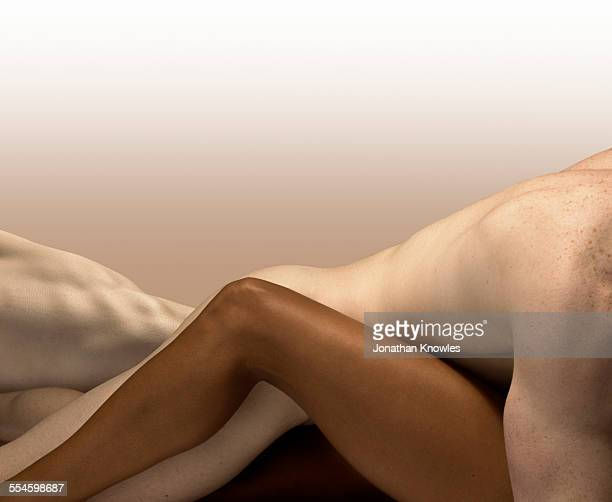 white male and dark skinned female,bodies embraced - sensuality stock pictures, royalty-free photos & images