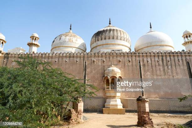 white marble abbasi mosque looks like a pearl in the wilderness of cholistan desert in pakistan - shrine stock pictures, royalty-free photos & images