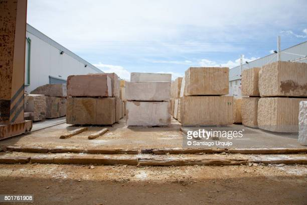 White marble blocks piled up on a factory