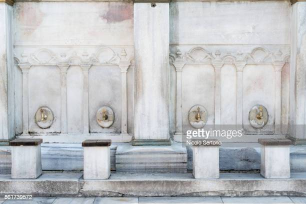 White marble public water fountain