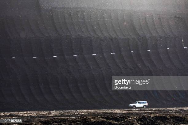 White markers indicate a coal rich area of excavated earth at the open pit lignite mine operated by RWE AG in Hambach Germany on Friday Oct 5 2018...