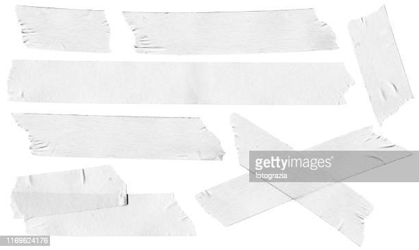 white masking tape collection - adhesive tape stock pictures, royalty-free photos & images