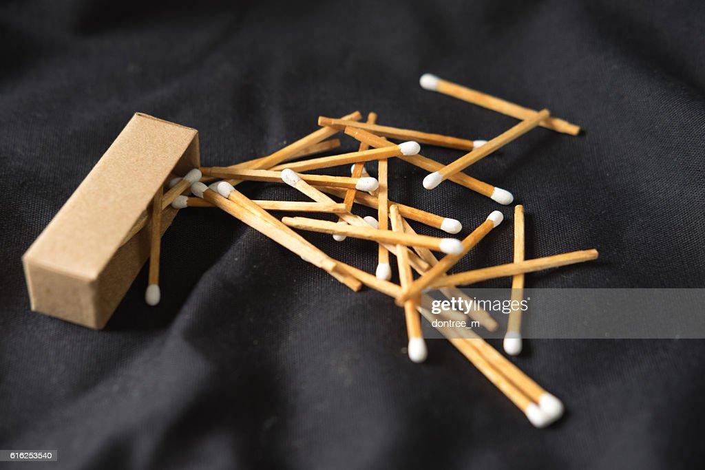 white matches on black background : Foto de stock
