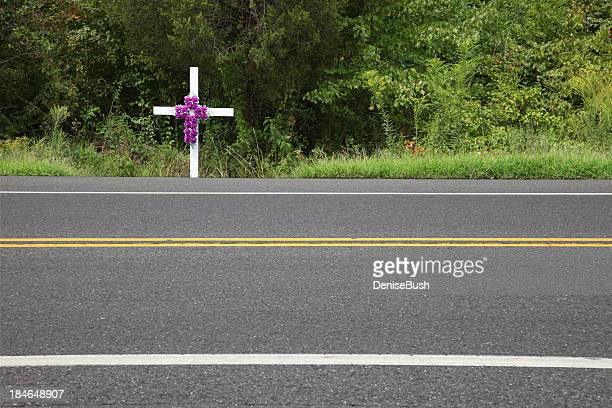 white memorial cross at the roadside - crosses with flowers stock pictures, royalty-free photos & images