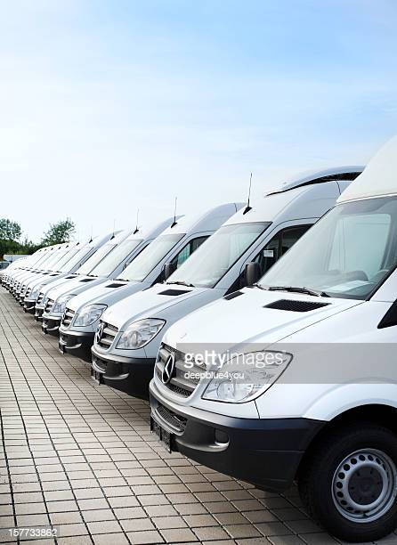 white mercedes-benz transporters in a row - van stock pictures, royalty-free photos & images