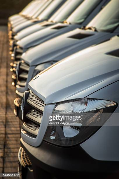 White Mercedes-Benz transporters in a row