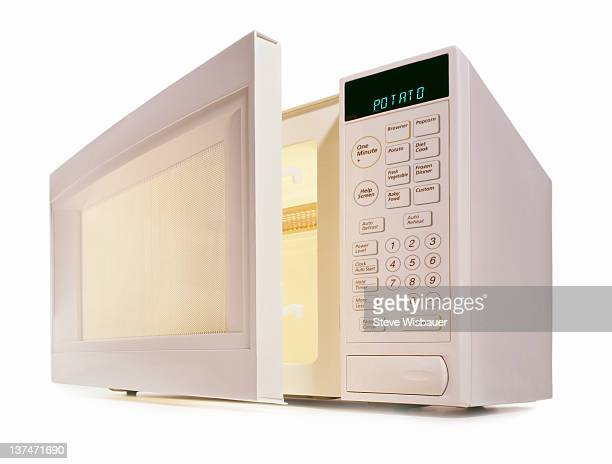 A white microwave oven with the door open