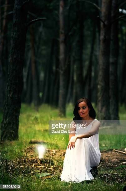 white middle-aged woman sitting in the forest - long dress stock pictures, royalty-free photos & images