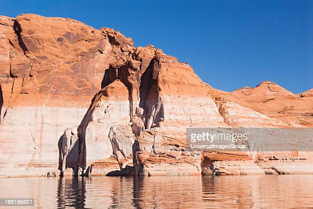 White mineral deposits on sandstone that used to be underwater shows the current low water level of Lake Powell due to drought conditions of the last...