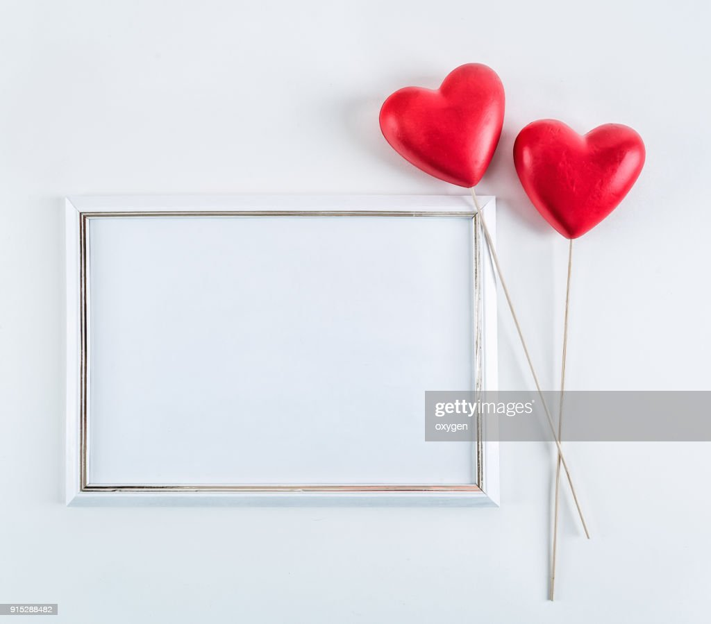 White Mockup Empty Frame With Two Red Hearts Stock Photo | Getty Images