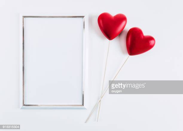 White mockup empty frame with Two Red Hearts