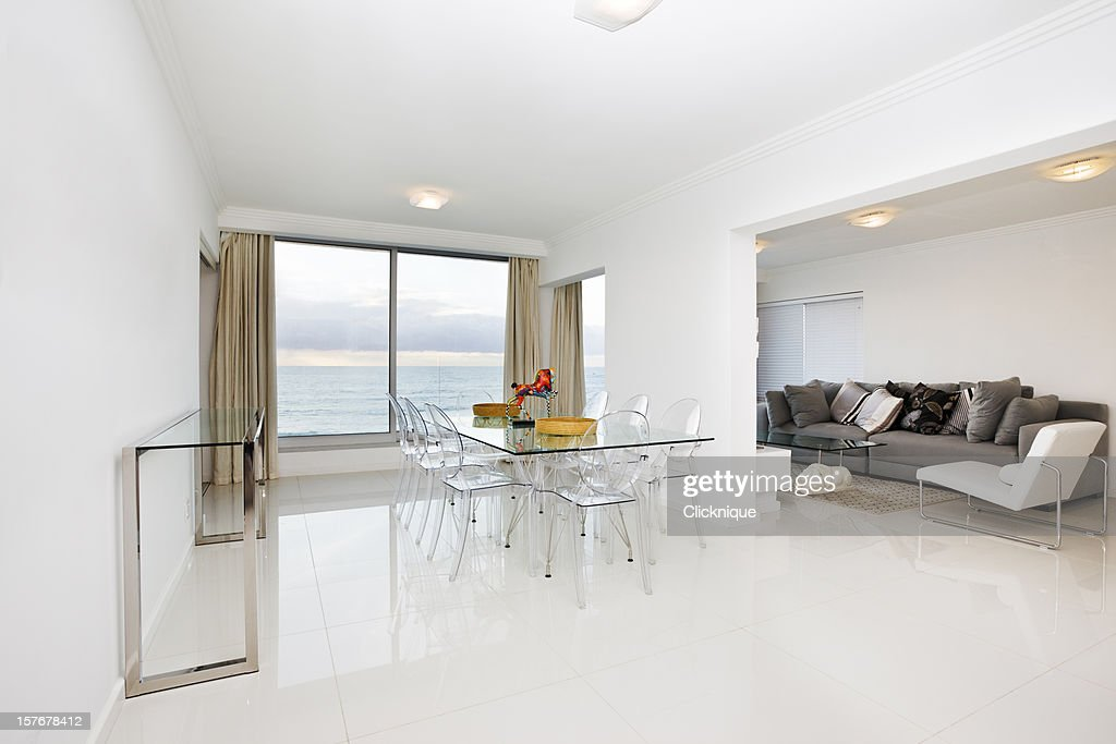 White Modern Dining Room And Lounge With A Scenic View : Stock Photo