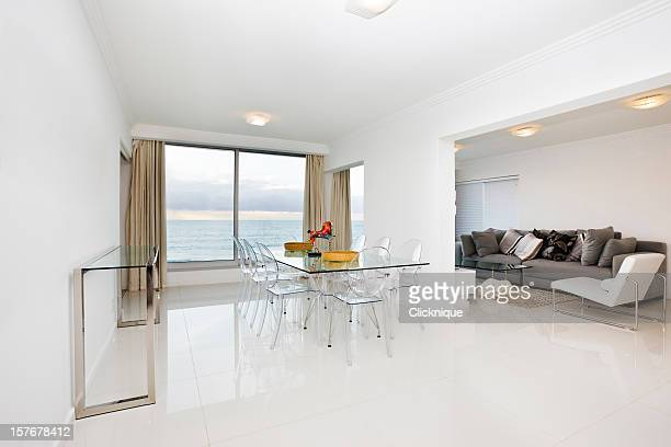 White modern dining room and lounge with a scenic view