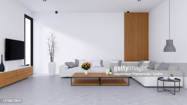 white modern living room design and cozy .white sofa with wooden tv cabinet on concrete floor - living room wallpaper stock pictures, royalty-free photos & images