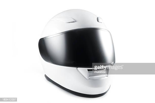 White motorcycle helmet with black visor on white background