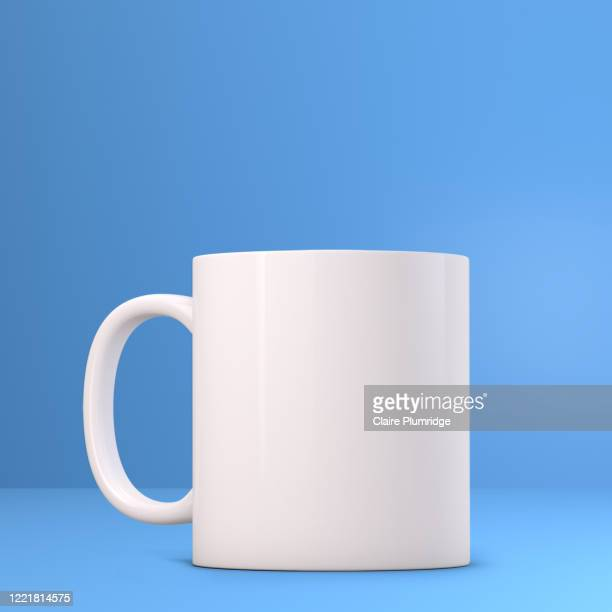 white mug mockup on a blue background. perfect for businesses selling mugs, just overlay your quote or design on to the image. - newbury england stock pictures, royalty-free photos & images