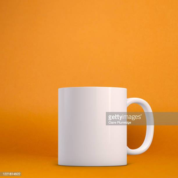 white mug mockup on a orange background. perfect for businesses selling mugs, just overlay your quote or design on to the image. - caneca imagens e fotografias de stock