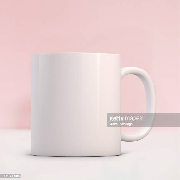 white mug mockup on a pale pink background. perfect for businesses selling mugs, just overlay your quote or design on to the image. - newbury england stock pictures, royalty-free photos & images