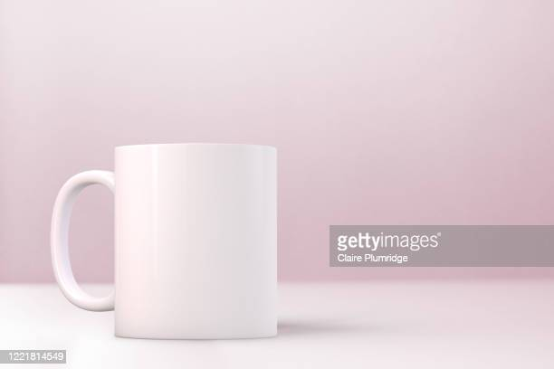 white mug mockup on a pink background. perfect for businesses selling mugs, just overlay your quote or design on to the image. - ウェスト・バークシャー ストックフォトと画像